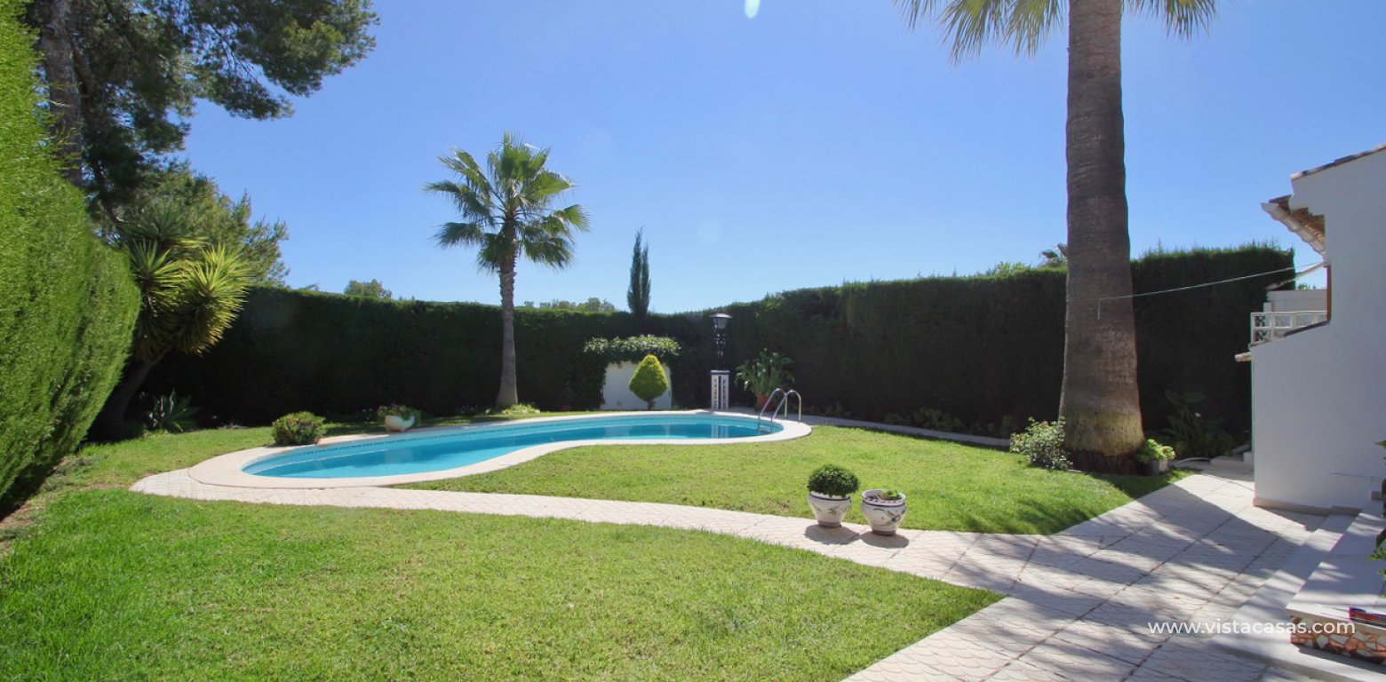 Frontline golf villa for sale in Villamartin pool